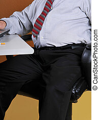 Overweight business man at his desk - Business man sitting...