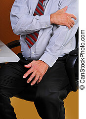 Businessman feeling pain in his arm - Man experiencing pain...