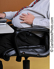 Man holding his bloated stomach - Middle aged man sitting in...