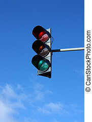Traffic lights on blue sky