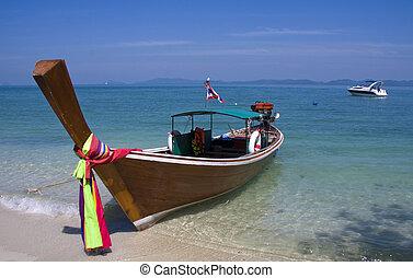 Long tailed boat and modern cruiser, Koh Naka, Thailand