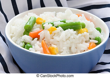 Blue bowl with cooked rice with mixed vegetable - Close up...