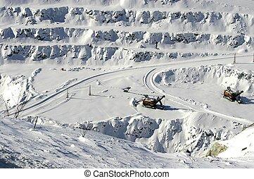 Open mine loader - Loader in open mine shaft in winter