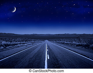 Starry Night Road - A desert road at night leading off into...