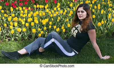 Girl flower garden sit down