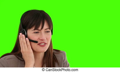 Friendly businesswoman speaking over the headset