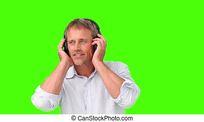 Casual man in shirt listenning to music