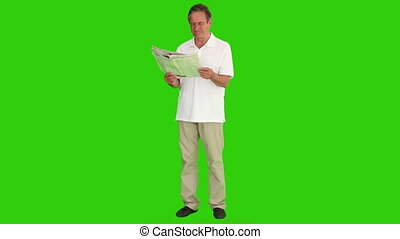 Senior man reading the newspaper - Chromakey footage of a...