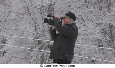Shooting video - Man filmed a beautiful winter nature