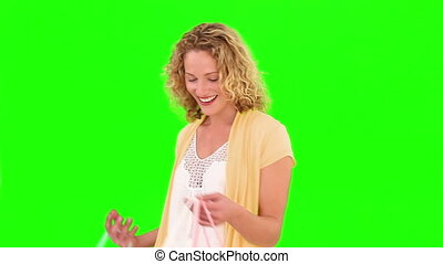 Curly blond haired woman carrying some shopping bags -...