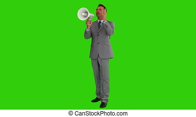 Businessman in a gray suit shouting through a loudspeaker...