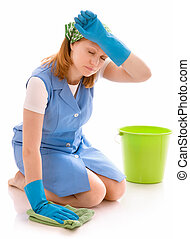 housecleaning - tired woman cleaning the floor with a rag