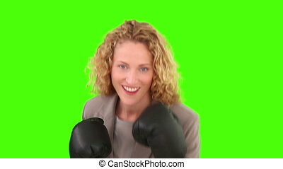 Pretty curly-haired woman with box gloves