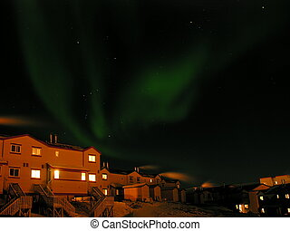 Northern Lights aurora borealis over the City of Iqaluit,...
