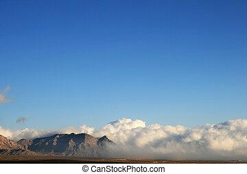blue sky over storm