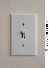 light switch on - wall mounted light switch turned up to the...