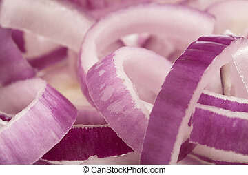 purple onion slices pile, extreme closeup photo