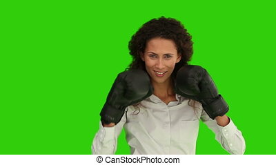 African woman with box gloves against a green screen