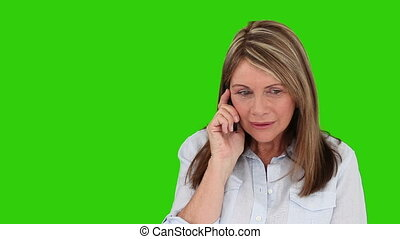 Retired woman talking on the phone