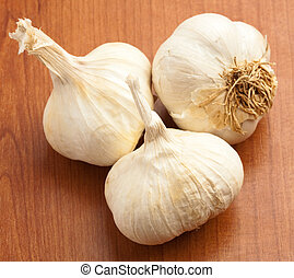 garlics - garlic on a wooden surface, closeup photo