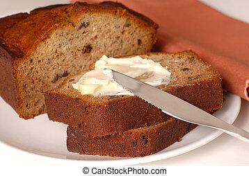 Banana walnut bread with butter on a plate