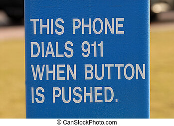 Sign giving instructions on dialing 911 - A Sign giving...