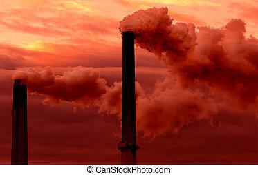 Smokestacks billowing smoke adding to global warming - Two...