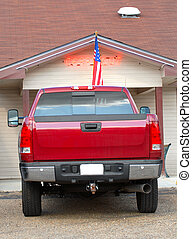 Red pickup truck outside a carry out restaurant - A red...