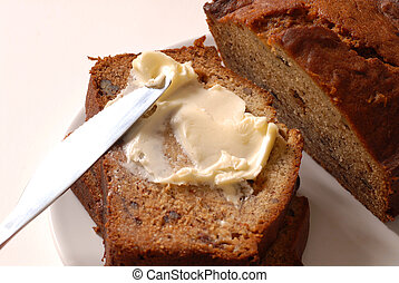 Banana walnut bread with a knife and butter