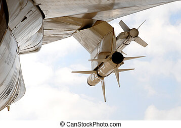 Sidewinder rockets attached to the wing of a jet plane - Two...
