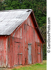 Old red barn located in rural Mississippi - An old red barn...