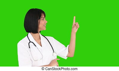 Asian nurse with a stethoscope looking at the camera -...