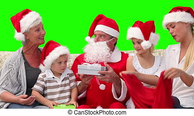 Santa Claus giving gift to a family - Chromakey footage of a...