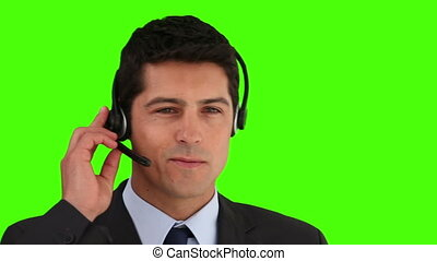 Businessman talking on the phone against a green screen