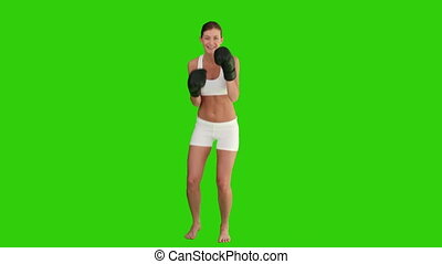 Pretty brown-haired woman with boxing gloves