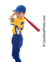 Boy swinging a baseball bat - A young boy swings a baseball...