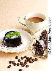 Coffee, coffee pudding and coffee beans in glass jar