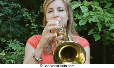 Trumpeter. Head-on. - Female musician playing a trumpet....