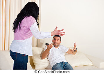 Family conflict - Wife and husband on couch having conflict...