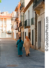 Maroc woman in Spain - Two maroc woman walking in the...