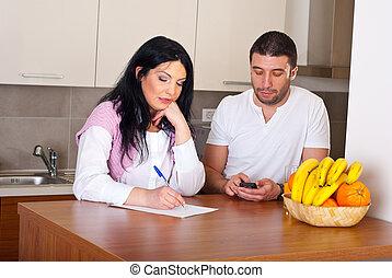 Sad couple calculate their bills