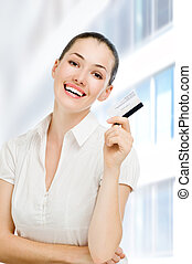 credit card - a young woman holding new credit card