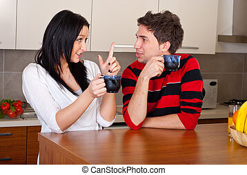 Young couple drink coffee and talking - Young couple...