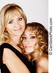 mother and daughter - beautiful real couple mother in her...