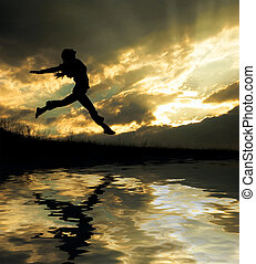 jumping girl - a jumping girl on the sunset background