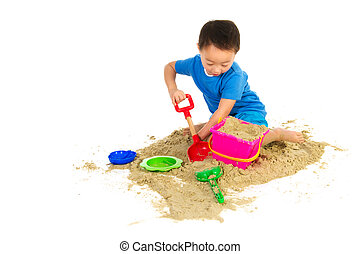 Chinese boy playing at the beach