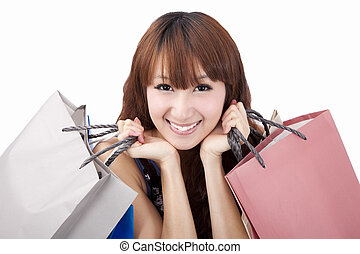 Smiling asian woman with shopping bag
