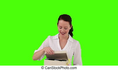 Brunette woman opening a gift - Chromakey footage of a...