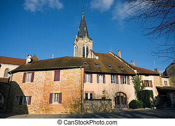 Village Scene, France - Houses and a church spire in a tiny...