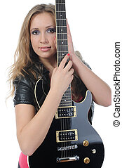 woman in a full-length with a black guitar - young woman in...